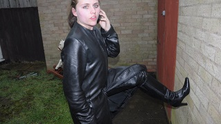 Lucy-girl-in-leather-boots-pants-and-leather-jacket-photos