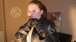 Lucy-girl-in-leather-gloves-black-leather-jacket