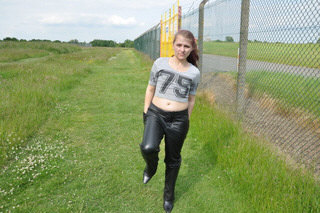 image Girl in leather gloves and leather coat