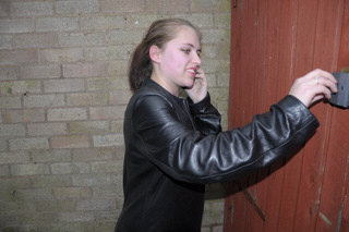 girl-in-leather-jacket-long-leather-boots-on-phone