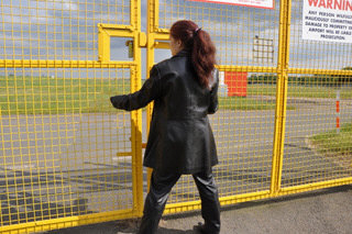 girl-in-leather-pants-leather-gloves-outside-garden