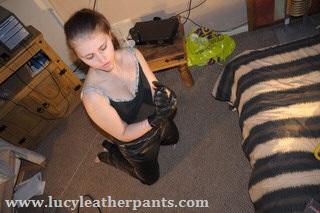 girl-kneeling-in-black-leather-pants