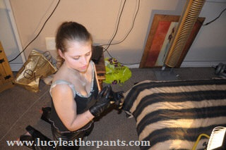 girl-looking-at-leather-gloves