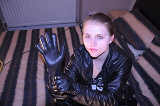 girl-in-leather-pants-and-leather-boots-with-jacket-gloves
