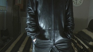 leather-clad-girl-leather-jacket-black-leather-gloves-leather-boots